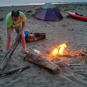 lighting the fire on the dune near venice
