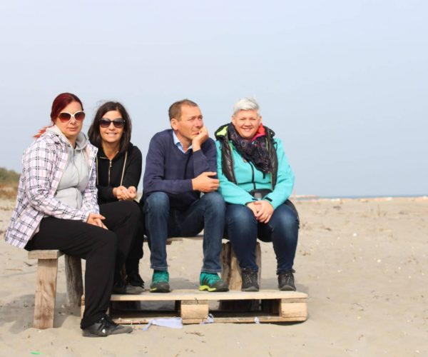 friends on beach in lagoon of vencice
